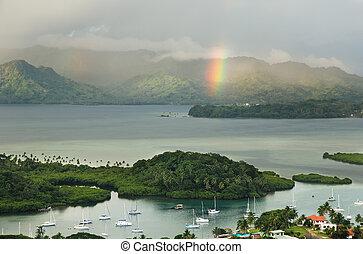 Savusavu marina and Nawi islet with rainbow, Vanua Levu island, Fiji, South Pacific