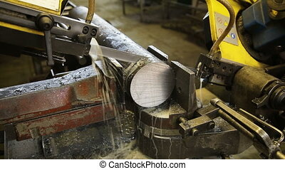 Saw cutting metal - Contour bandsaw in the workshop.Band saw...