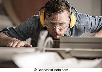 Saw operator preparing ideal board - Horizontal photo of ...