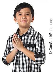 Sawasdee  - A Smilling Thai boy paying respect