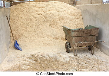 sawdust mountain ready to be used to dry the stables