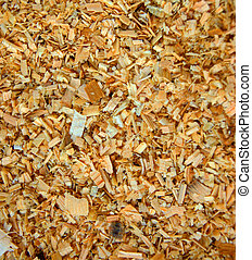 Sawdust on the ground. Background from wooden sawdust