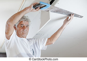 Sawing into the ceiling