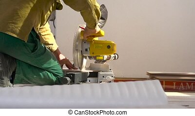 Sawing laminate pieces with electric saw. Super Slow Motion