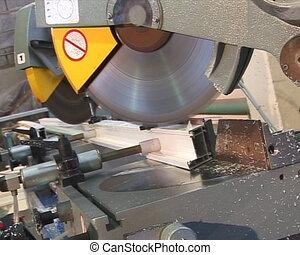 Sawing metal. - Sawing metal profile.