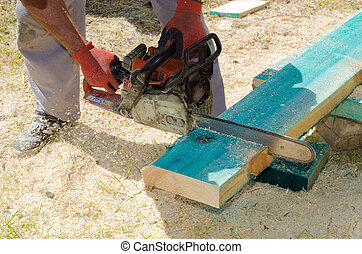 Sawing wooden beam