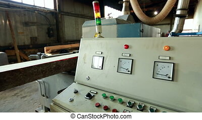 Sawmill. View of control panel and machine running, close-up