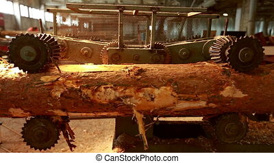 Sawmill. View of log moves by machine - Sawmill. View of log...