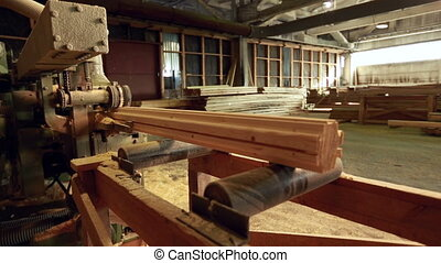 Sawmill. View of pulling profiled timber, close-up