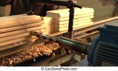 Sawmill. View of running machine tool with drill
