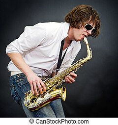 Sax solo - A saxophone player fully entranced into his own...