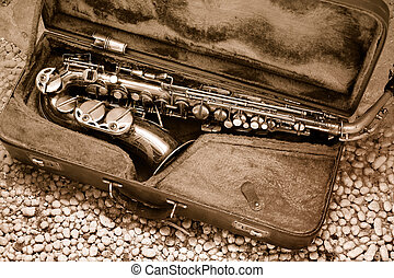Saxophone in old leather case