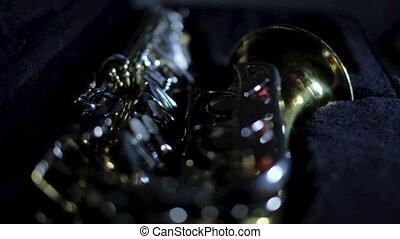 Saxophone on a dark background in case