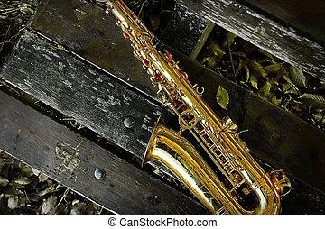 Saxophone on bench