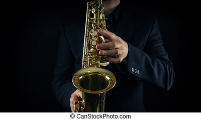 Hands playing the saxophone front view
