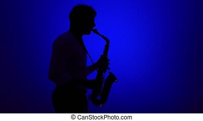 Saxophone player on a blue background.