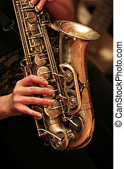 saxophone player - Saxophone player on dark background.