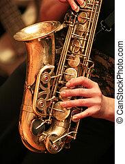 saxophone player - Saxophone player on dark background.
