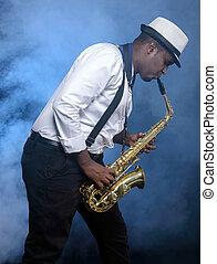 Saxophone player - Saxophonist black men in white shirt....
