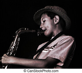 Saxophone Player - Young boy playing a saxophone, shot on...