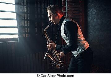 Saxophonist playing jazz melody on saxophone