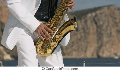 Saxophonist playing on golden saxophone