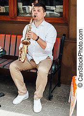 saxophonist playing saxophone jazz music