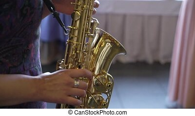 Saxophonist woman playing sax
