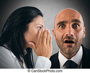 Say a gossip - Woman talking in secret to a man