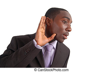 """This is an image of a business man with his hand to his ear, as if to say """"Say what?!""""."""