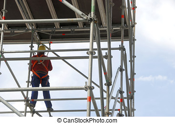scaffold and worker - worker on a scaffold