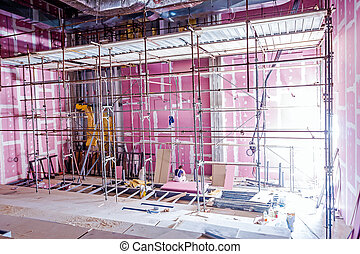 Scaffold in theater under construction with plasterboard walls, Gypsum wall