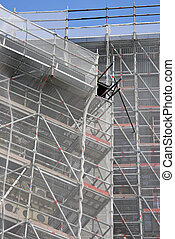 Scaffold on a building, a construction site