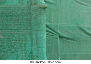 scaffold under debris netting at construction site
