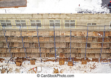 Scaffolding along the wall of a house under construction, view from above