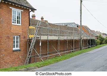 Scaffolding and roof repairs on a house in UK