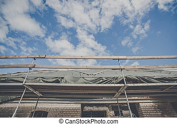 Scaffolding at a house improvement of the roof