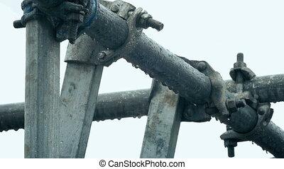 Scaffolding Dripping In The Rain - Closeup of metal...