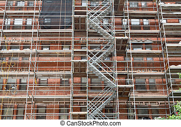 Scaffolding Old Brick Building Under Renovation