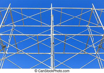 scaffolding on blue sky