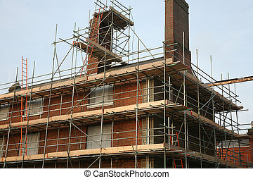 Scaffolding on industrial brick building in england