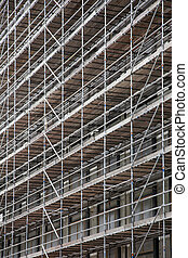 scaffolding on facade of high rise building