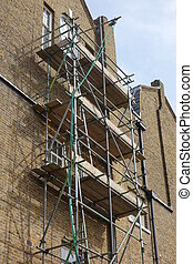Scaffolding on Tall Brick Building - Scaffolding on side of...