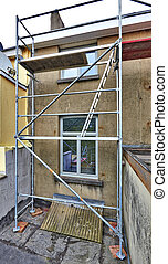 Scaffolding on terrace against dirty and grunge wall