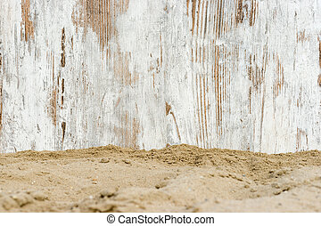 scaffolding on the sand - wheathered wood on the beach