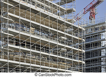 foreshortening of a swarm of scaffoldings at a building site in milan, shot in brilliant light
