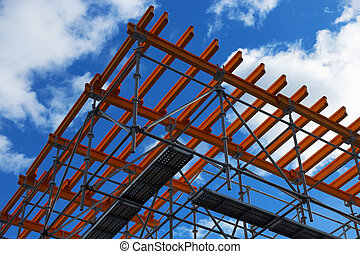 scaffolding - System of scaffolds against blue sky and...