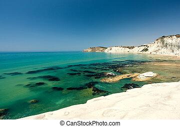 Scala dei Turchi is a fascinating limestone rock steep on a wonderful sea near Agrigento in Sicily (Italy)