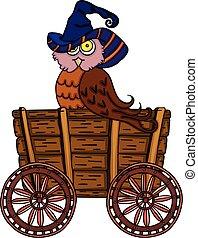 Halloween owl in wooden trolley