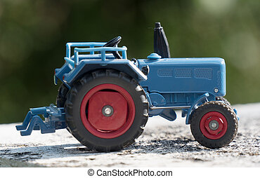 Scale model of blue farm tractor